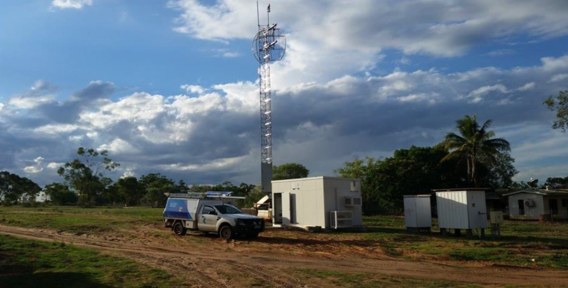 Telstra vehicle in front of a mobile tower in remote NT
