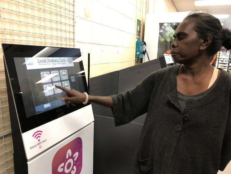 Aboriginal lady using a Hitnet Hub terminal